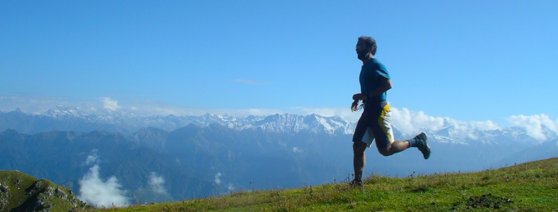 Blue sky above, Himalayas behind and green Earth underfoot... what a place to be alive.