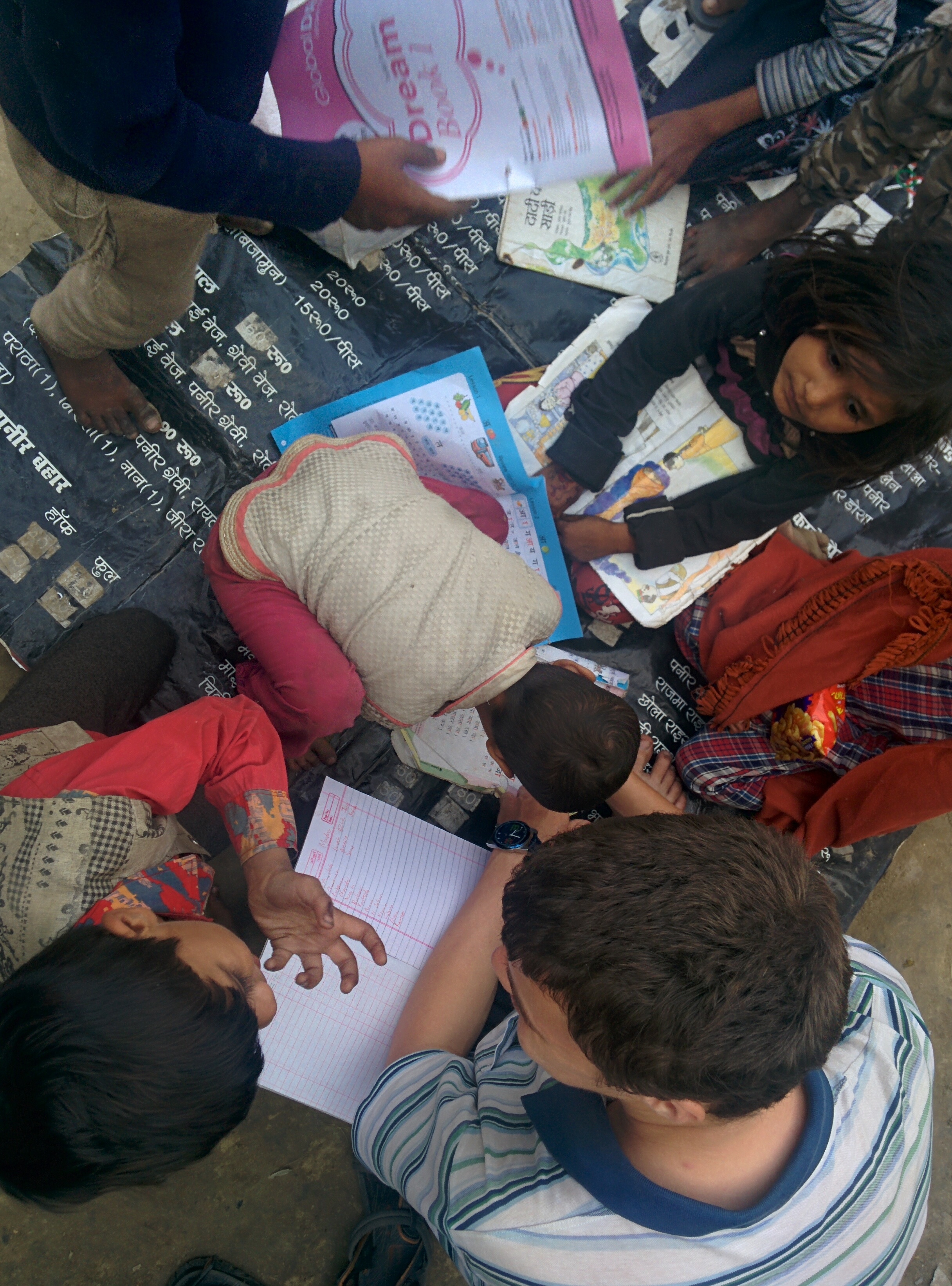 Tom teaching literacy with bustee kids in Lucknow.