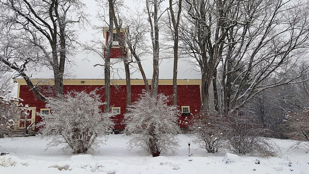 The Preserve at Chocorua Barn during a snowfall.