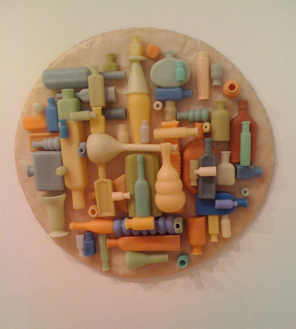 Bottletondo , 2006: beeswax, wood, 25 x 24 inches