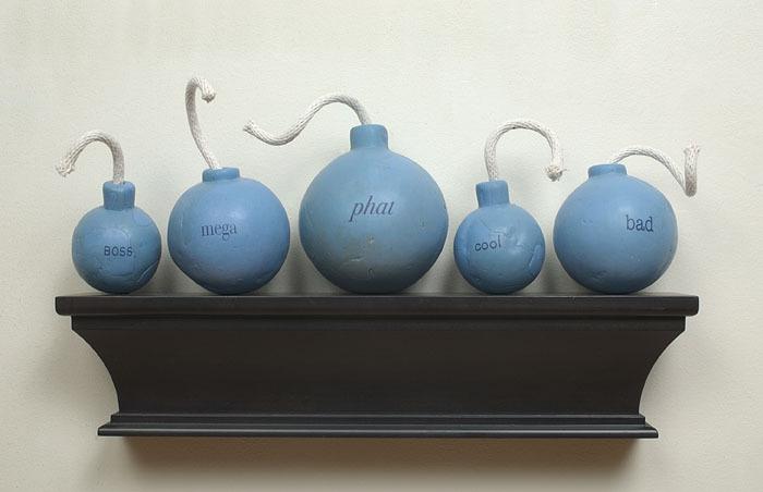 Da Bomb Squad,  2003: wax, cotton cord, applied text, wood; 13 x 30 x 7 inches