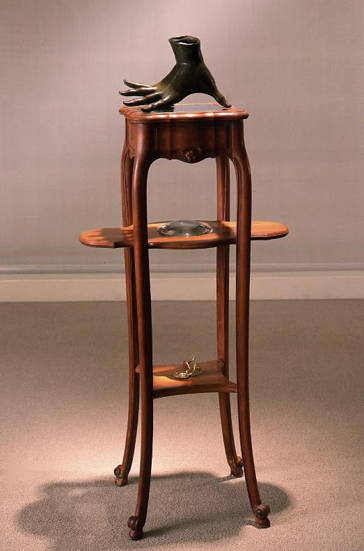 "Learning through the skin,  1995-6: bronze, wood, glass, 42"" x 12"" x 12"""