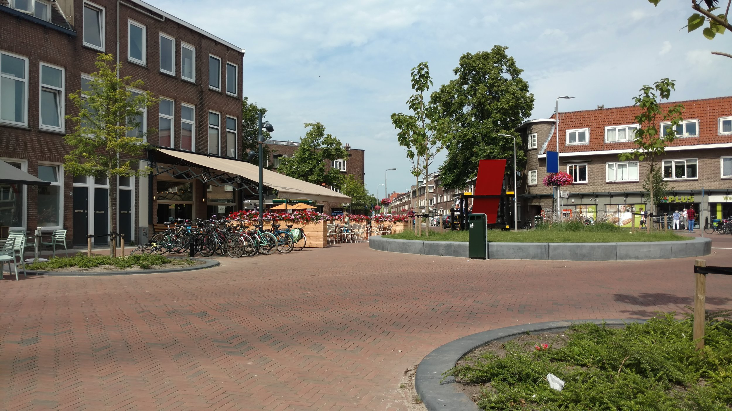 The intersection where cars can still technically travel, but the street design signals that the space is more for bikes and pedestrians.