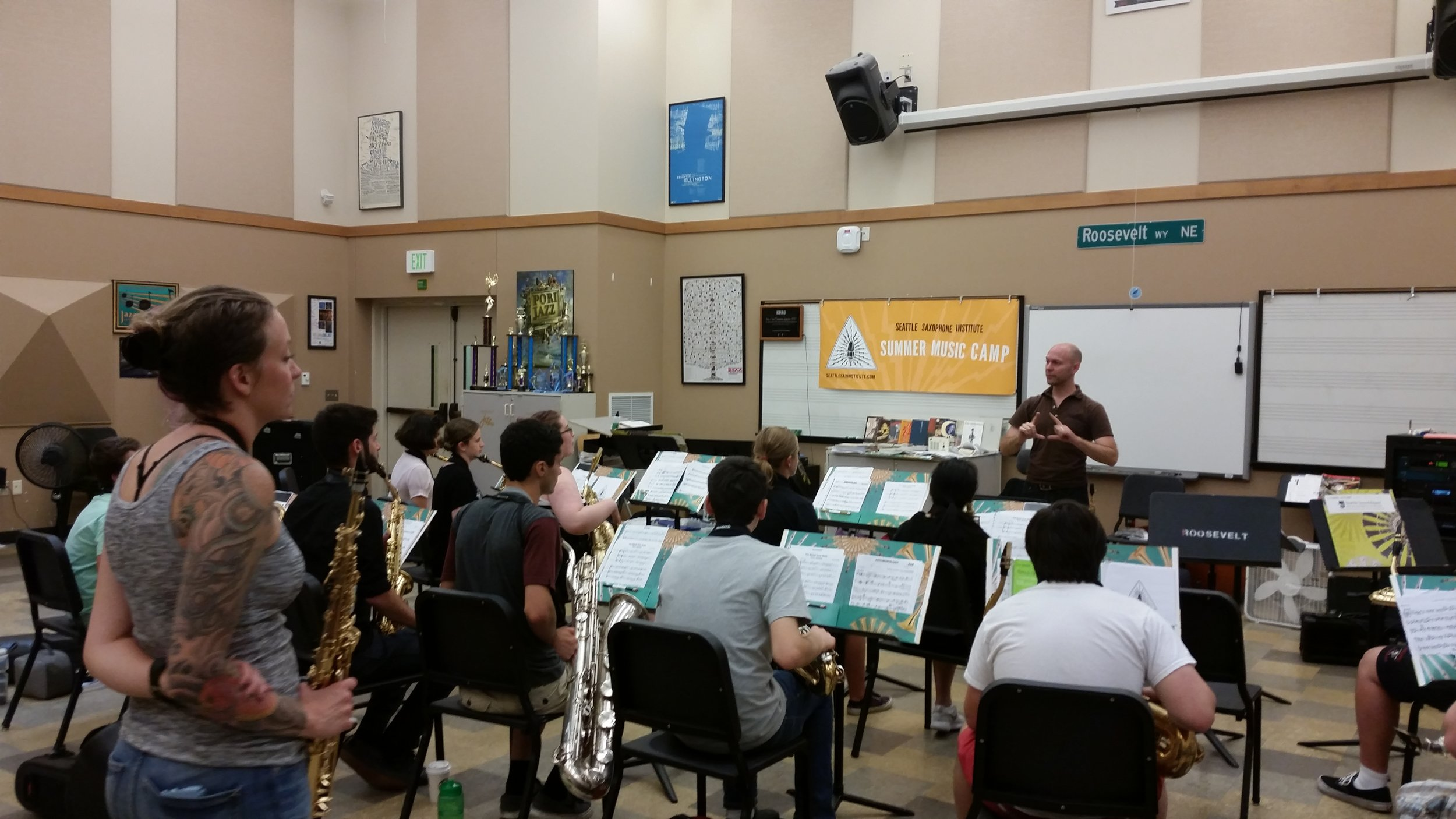 Sax Institute coach Kate Olson looks on and learns along alongside students during a guest artist presentation and performance