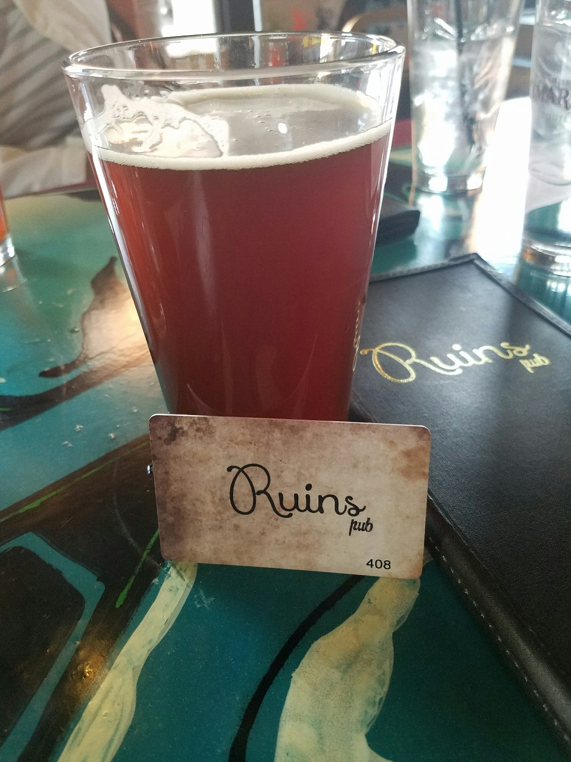 Ruins Pub tap card and delicious beer!