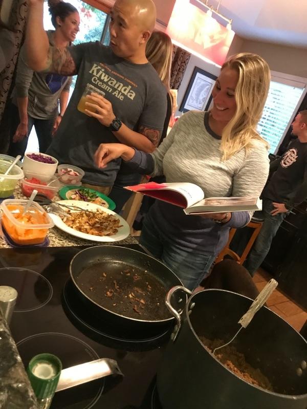 Stephanie seasoning Chrissy Teigen's fish tacos!