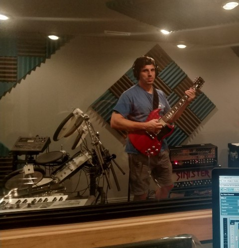 Mike Aiello of Cary IL rocking out in the studio during his guitar lesson with Mike Walsh.