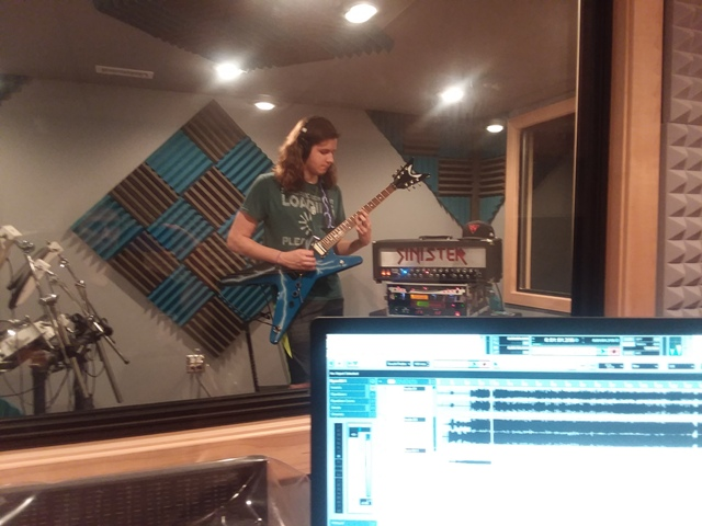 Ryan Babal of Mt.Prospect shredding away during his guitar lesson with Mike Walsh.