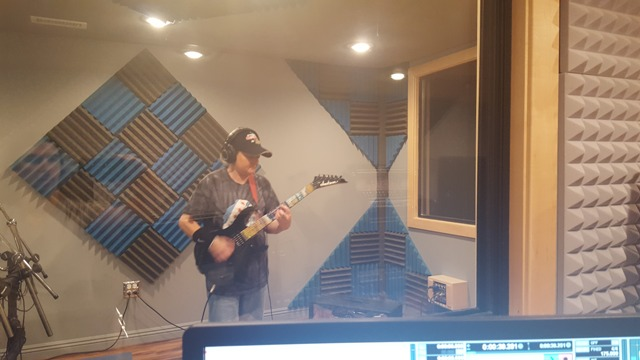 Northbrook student Alison Meyers records another rock song in her guitar lesson with Mike Walsh.
