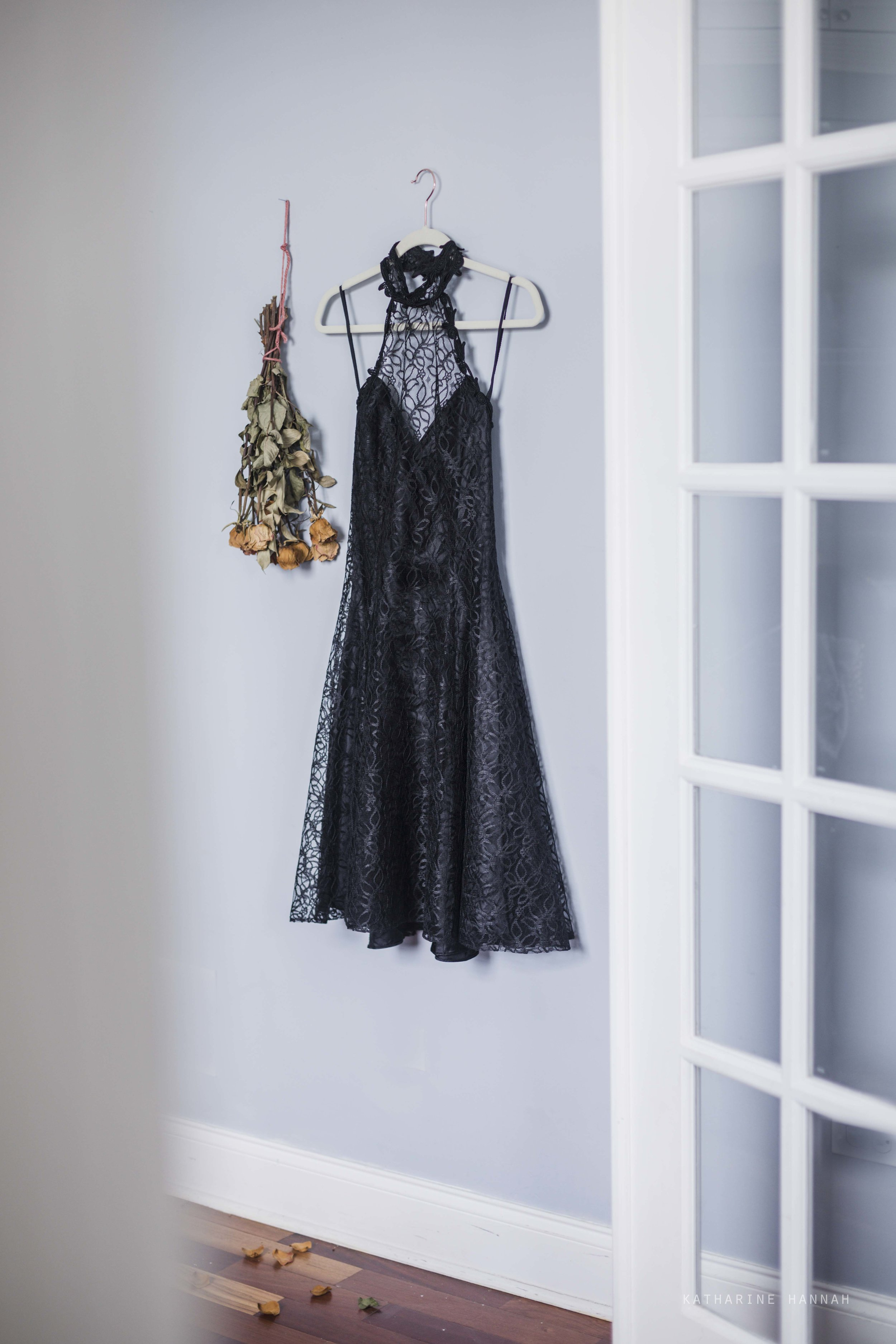 French glass doors in Chicago photo studio with black lace dress