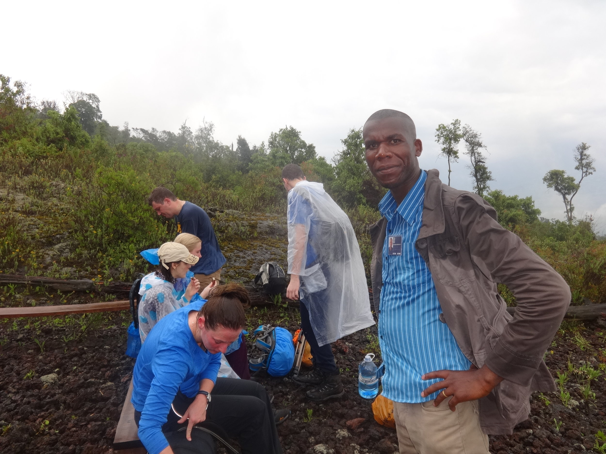 After awhile trekking upwards to the summit of nyiragongo volcano there came a downpour but good enough they were prepared.