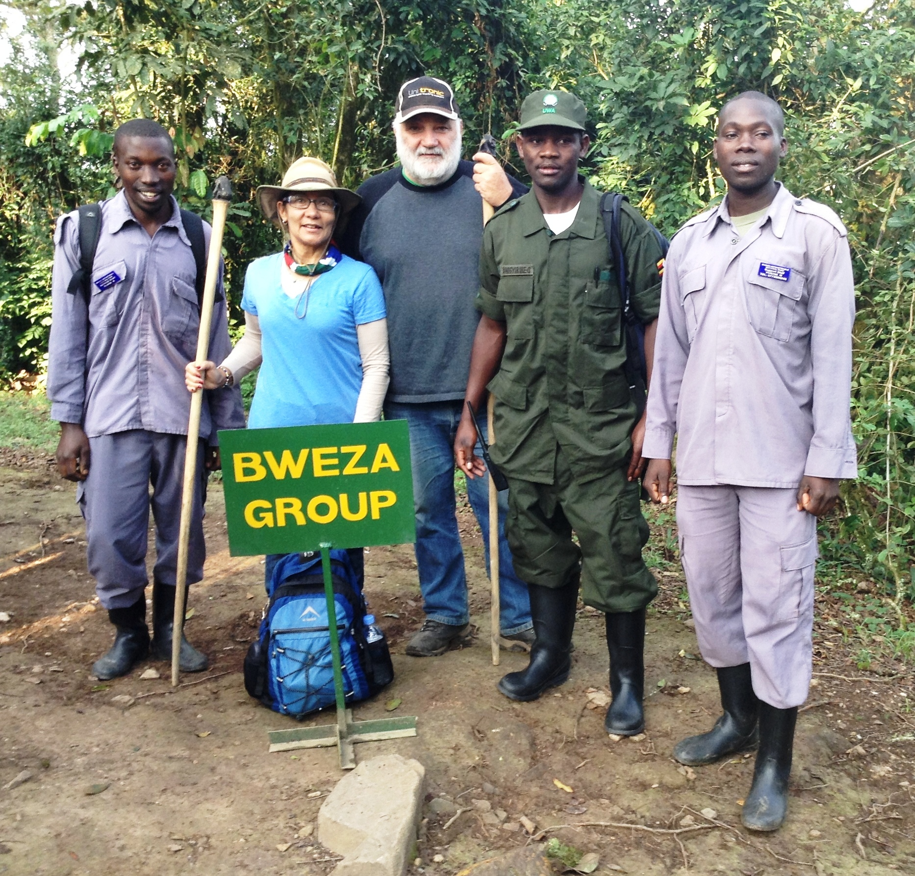 tourists with their poters and the lead guide on group briefing to go trekking mountain gorilas inside bwindi forest with Instinct safaris in Uganda