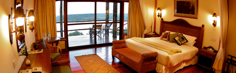 Queens cottage at Mweya safari lodge with Kazinga views through the window.