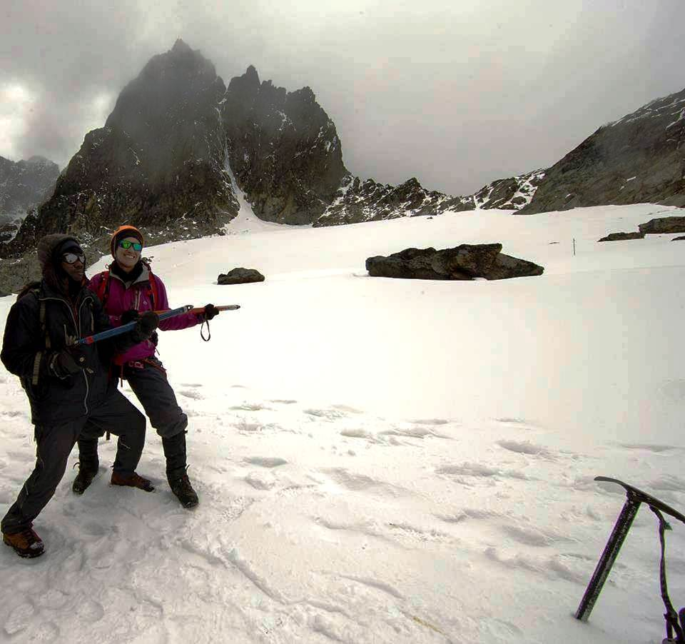 Tourists celebrating success at one of the highest peaks of MT.Rwenzori,Margherita Peak the highest peak rising to 16,795 feet (5,119 m).