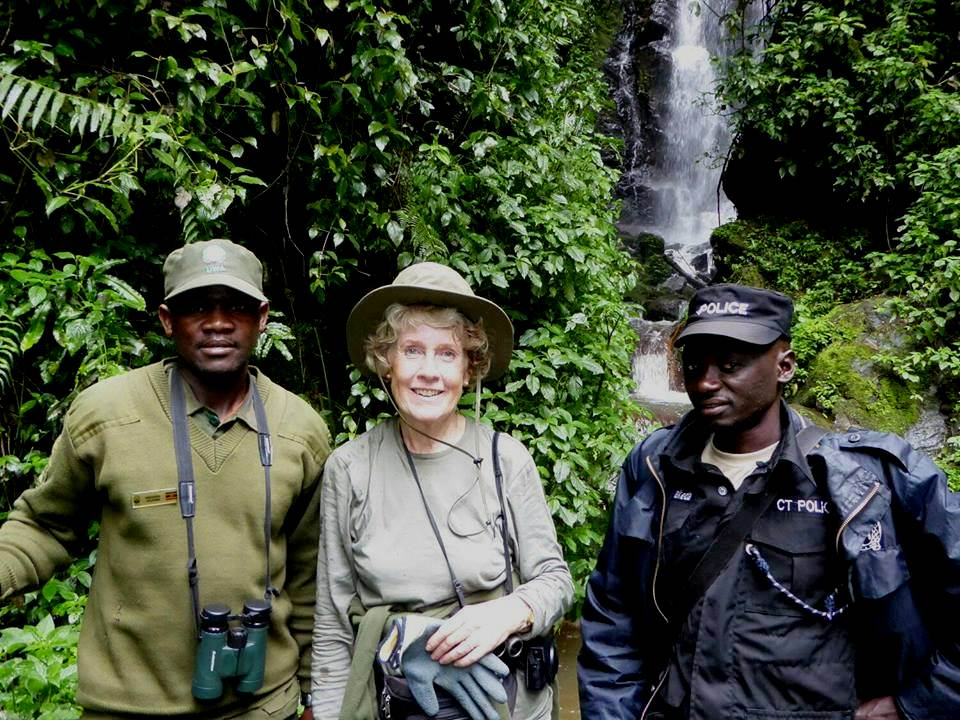 Wildlife conservation ranger, tourism police and atourist inside Bwindi forest.