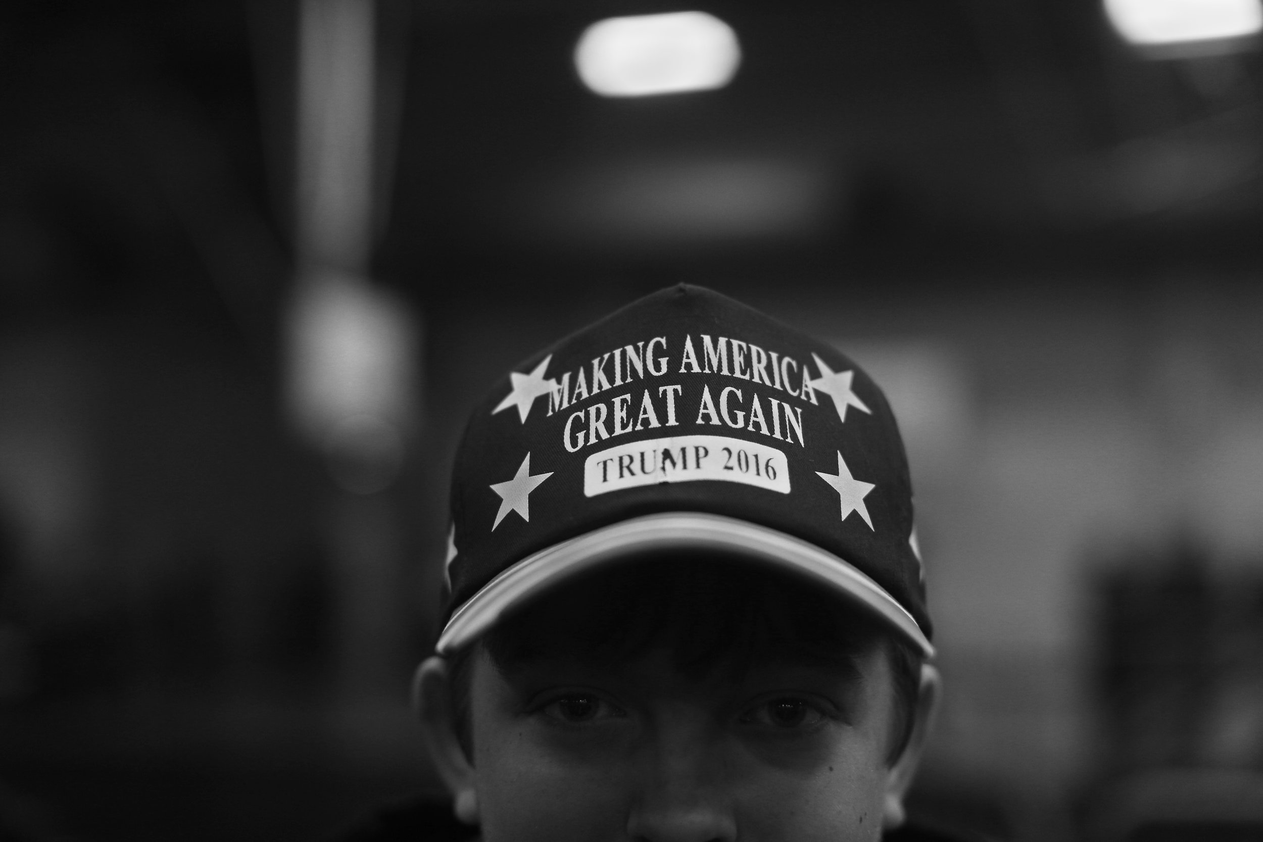 "A Donald Trump supporter wears a ""Making America Great Again"" hat inside the Field House on Tuesday, Jan. 26, 2015. A large crowd gathered to hear Trump speak on issues related to his campaign. (The Daily Iowan/Brooklynn Kascel)"