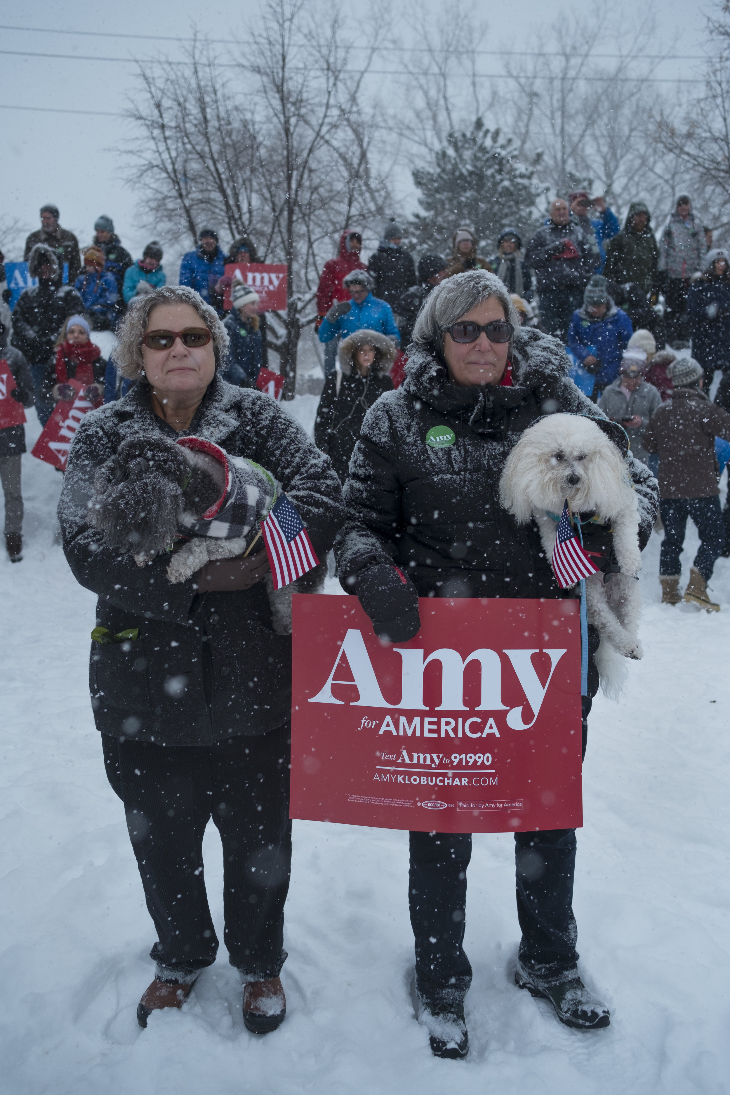 Supporters join at Boom Island Park in Minneapolis, Minnesota on Sunday, Feb. 10 to await Sen. Amy Klobuchar's, (D-Minn.), announcement in running for president in 2020. Those is favor, and those in opposition, gathered amid freezing temperatures and heavy snowfall. (Photo by Brooklynn Kascel)