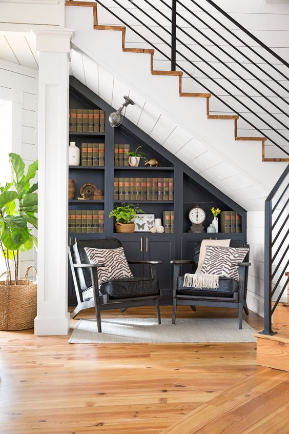 These built-ins by Joanna Gaines are a great use of space for an awkward corner under the stairs. See the home tour as featured in Country Living Magazine  here .