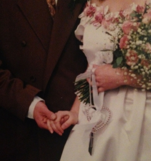 My father holding my mother's hand on their wedding day. Sunderland, circa 1990.