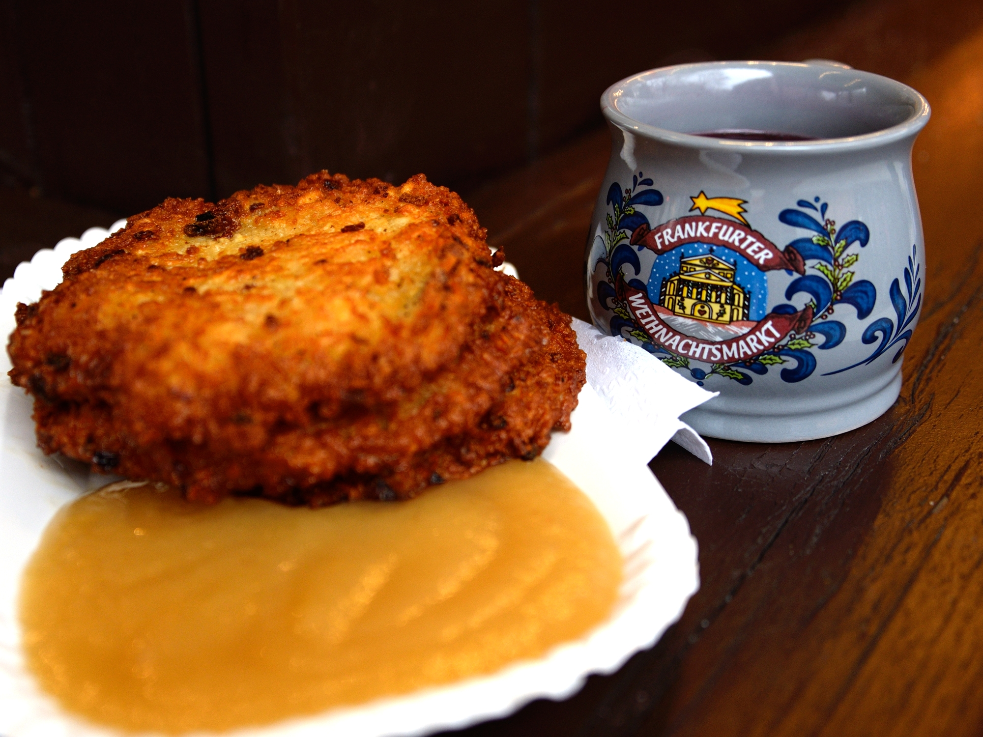 Potato cakes with apple sauce and a cup of Feuerzangenbowle