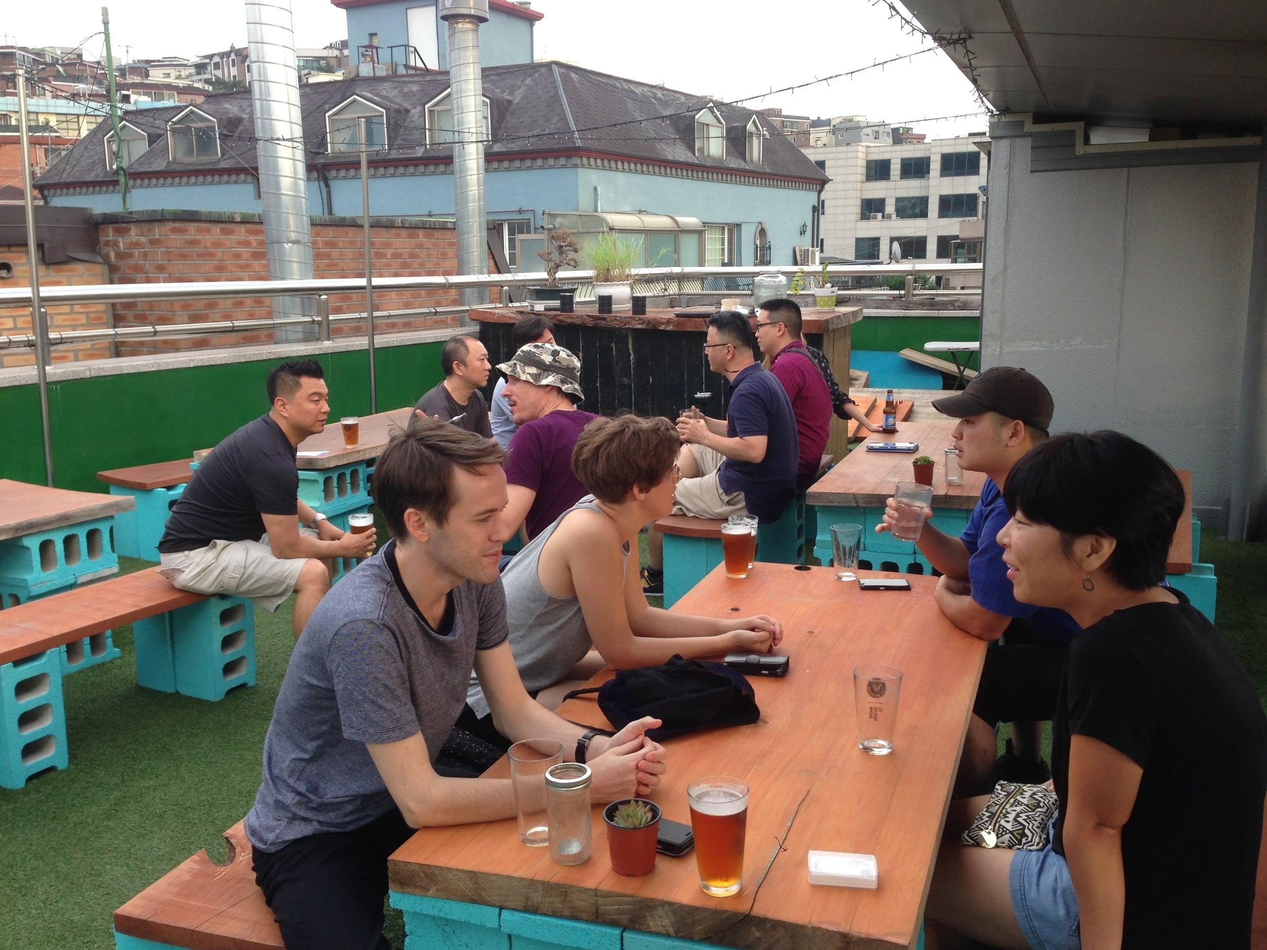 Real estate investors talking real estate on Southside Parlour's rooftop