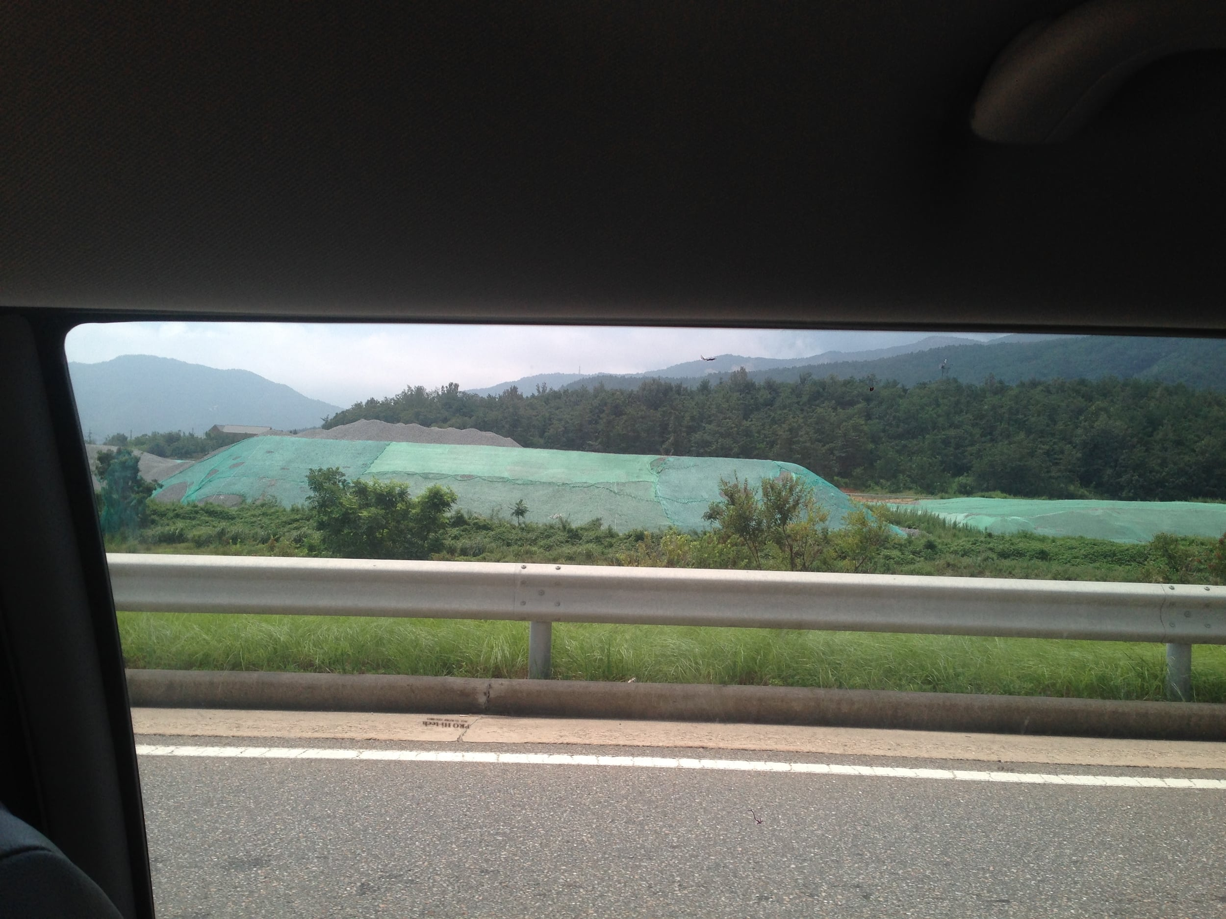 You can see the highway construction under the green tarp.