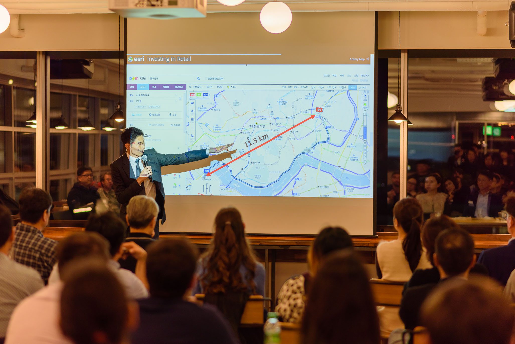 Raymond showing members of the Seoul Real Estate Investing Meetup the distance between Dongdaemun-gu and IFC Mall in Yeouido. (Photo by Cristian Bucur)