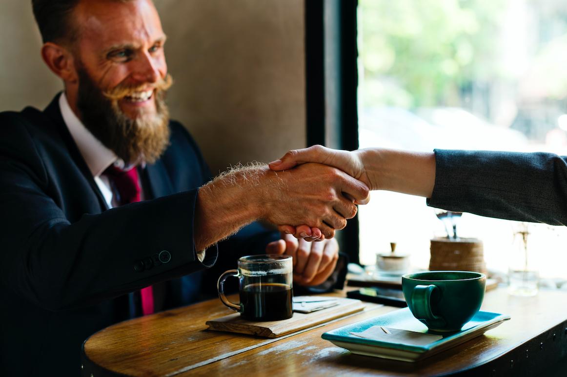 people shaking hands meeting
