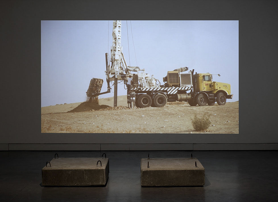 In the Desert   2009   HD, sound, one channel, 17:28 min / Two concrete blocks, 30 X 110 X110 cm each Collections: MJS collection, Paris. HOCHE collection, Paris. Petach Tikva Museum of Art.   Photographer: Elad Sarig