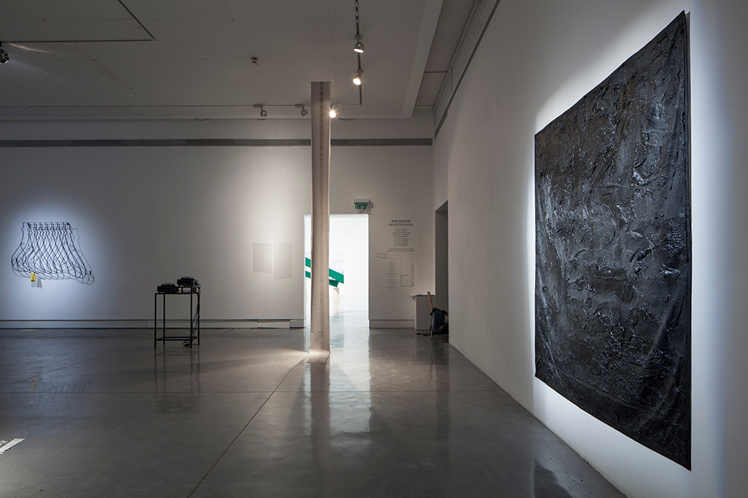 Installation View: to the right : Black Ground, 2013, bituminous mastic, acrylic, gesso on canvas, Size: 197.5 X 197.5 CM at Petach Tikva Museum of Art.   Photographer: SJM
