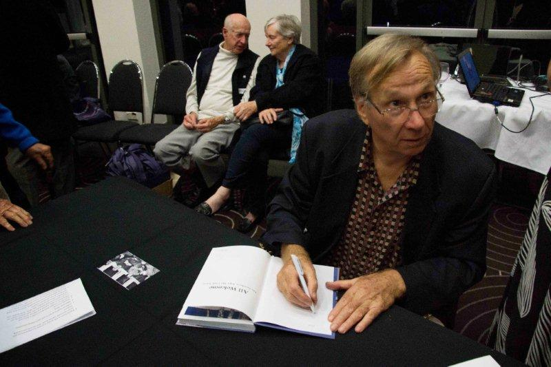chas signing a book.jpg