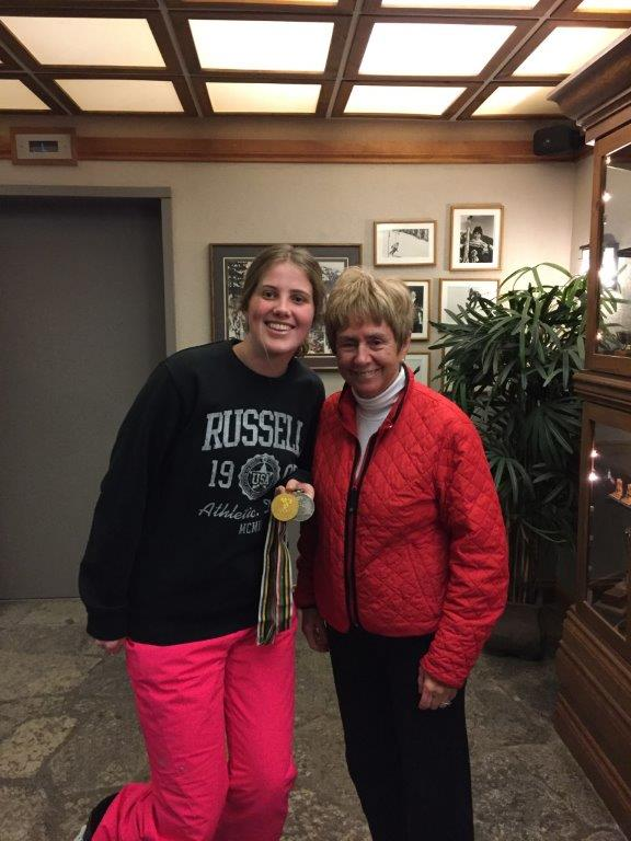 Nancy Greene at Cahilty Lodge showing Jess her Olympic medals