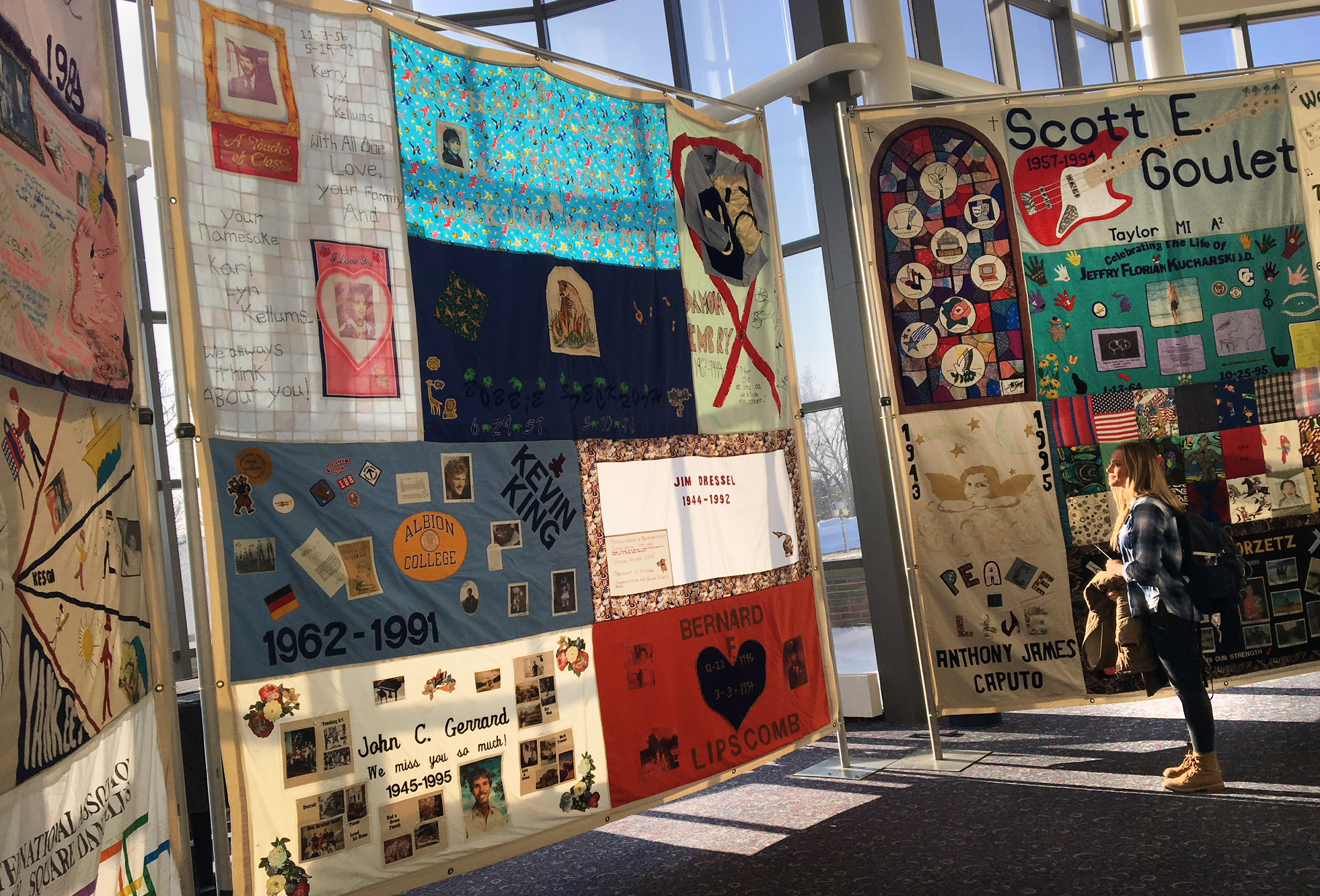 Panels from the Names Project, also known as the AIDS Quilt, on display in the Gilmore Theatre Complex Atrium