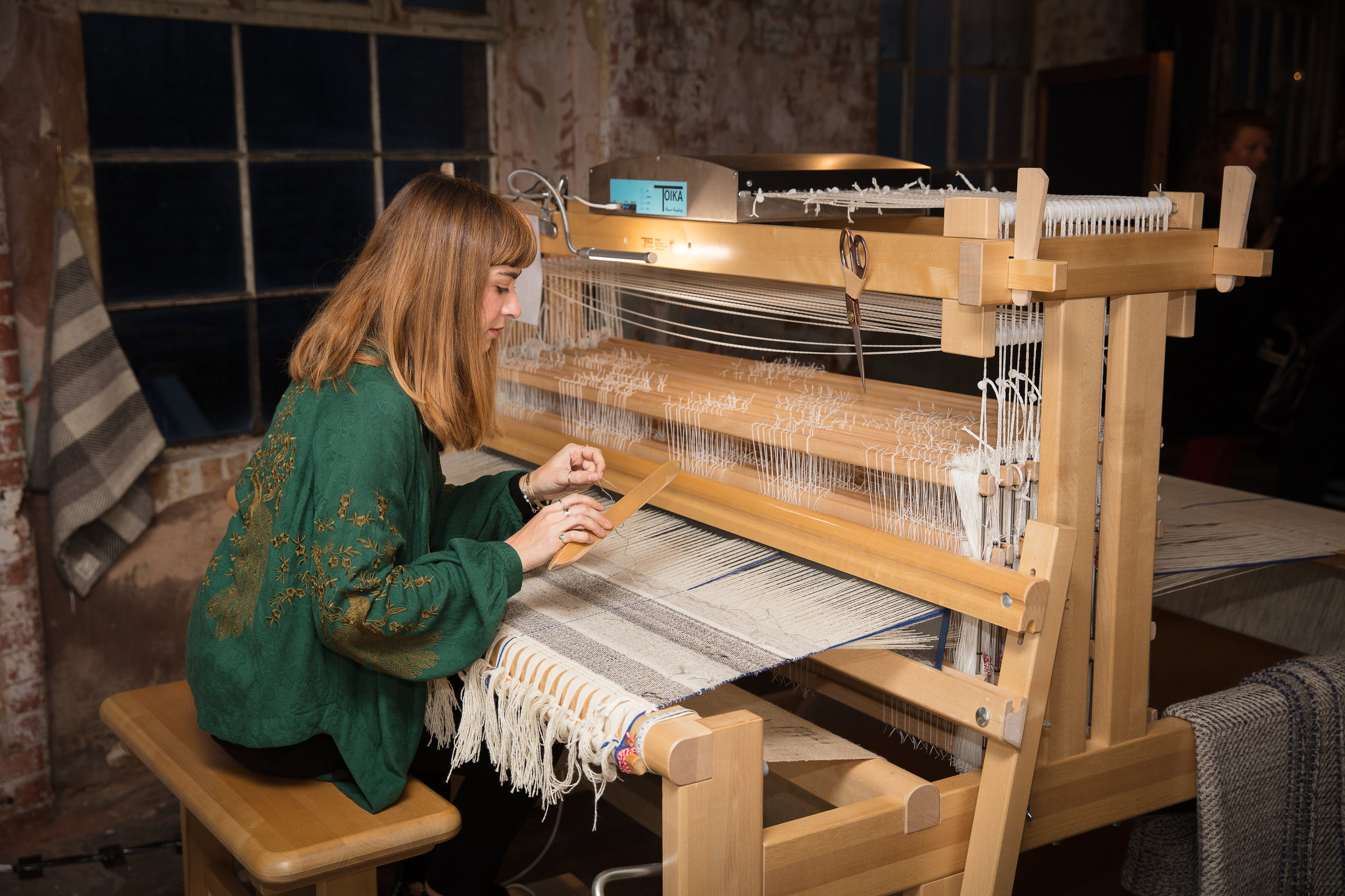 Maria Sigma hand-weaving at The Future of Craft, Oxo Tower Wharf CREDIT: DAN WEILL