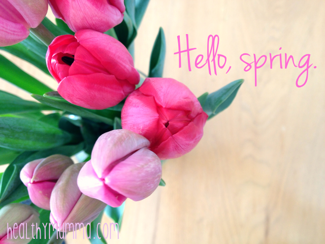 birds eye view of pink tulips in a vase and the text hello, spring