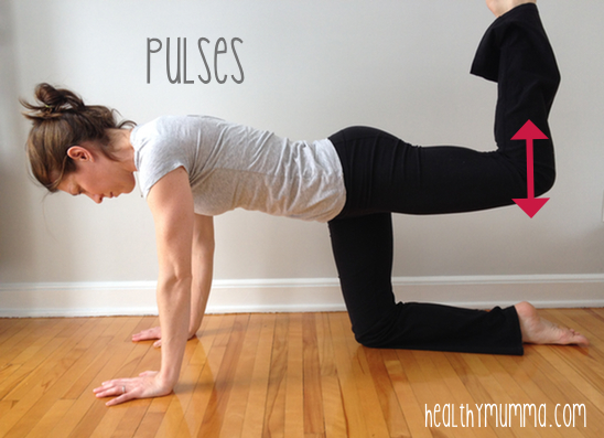 woman on all fours doing butt strengthening exercise
