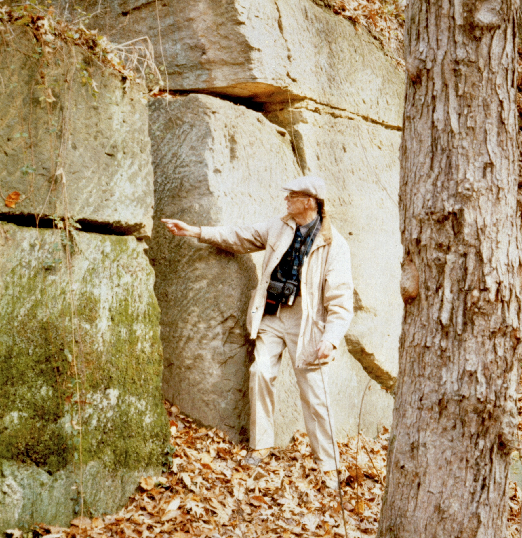Lee Nelson examines Aquia Creek sandstone at the quarry that supplied stone for the White House.