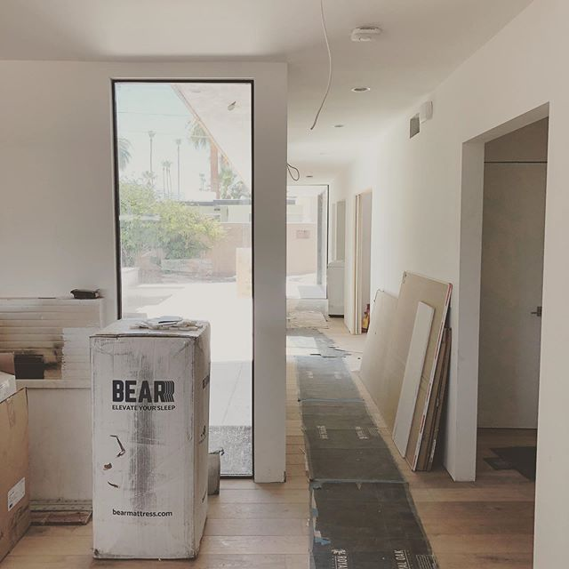 With this hallway addition and a little space reorganization, we turned an awkward 2 bedroom house into a lux 4 bedroom 4 bath retreat for a family of 5! #smartspaces #midcenturymodern #mcmrenovation #psmodern #hardwoodfloors @milgardwindowsdoors @western_window_systems