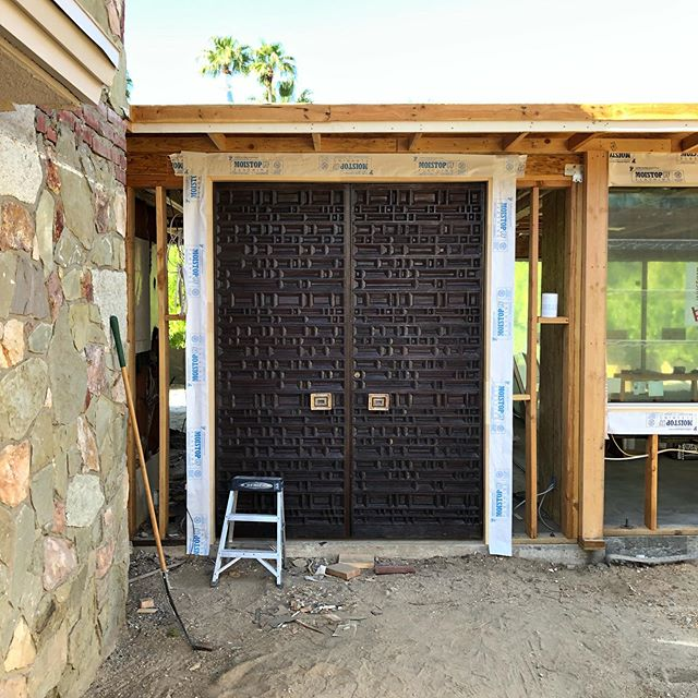 Reclaimed front doors are in at this Mesa renovation! . . . . . #architecture #modernarchitecture #mcm #mcmreno #palmsprings #modernarchitecture #residentialdesign #frontdoor #reclaimed #themesa
