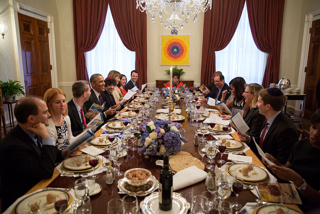 President Barack Obama and First Lady Michelle Obama host a Passover Seder dinner in the newly redecorated Old Family Dining Room of the White House in Washington, D.C., on April 3, 2015. By White House. Pete Souza, photographer. [Public domain], via Wikimedia Commons