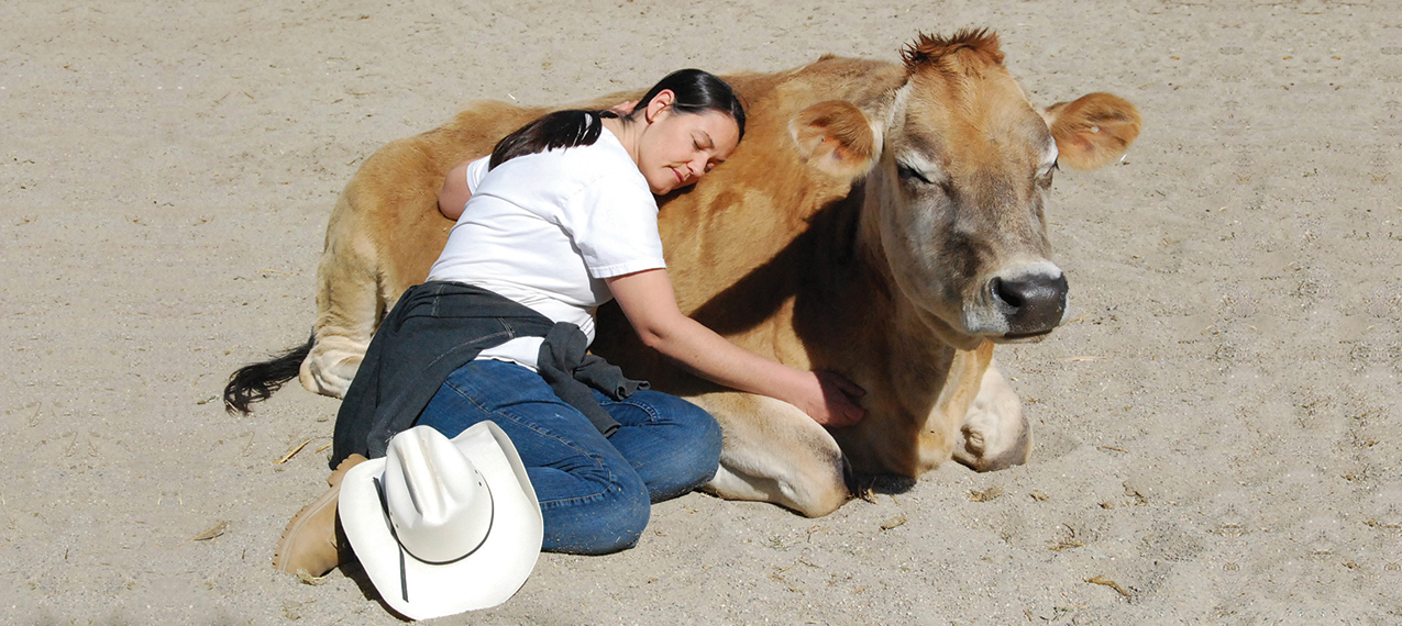 """I believe we haven't lived life until we have hugged a cow,"""" says Ellie Laks, shown hugging Buttercup, """"a Jersey cow with a sweet and loving energy that makes everything better."""""""