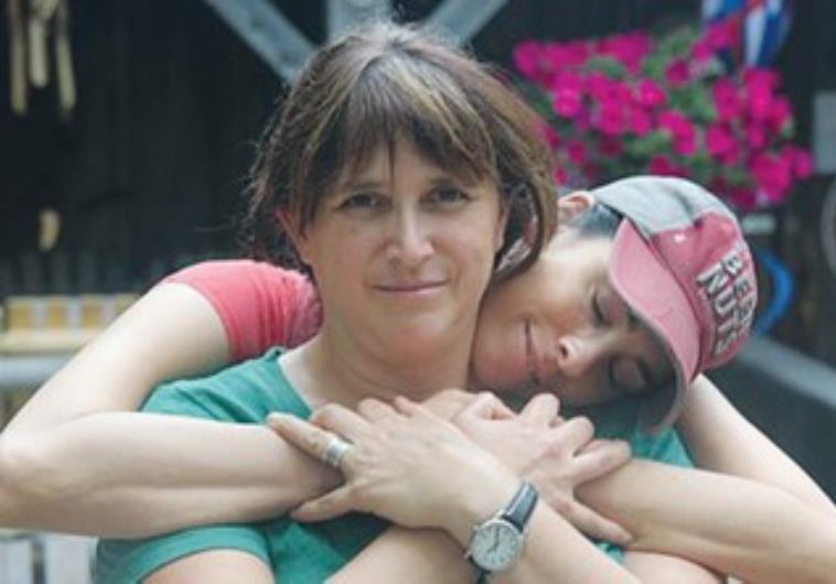 Comedian Sarah Silverman embraces her sister, Rabbi Susan Silverman.