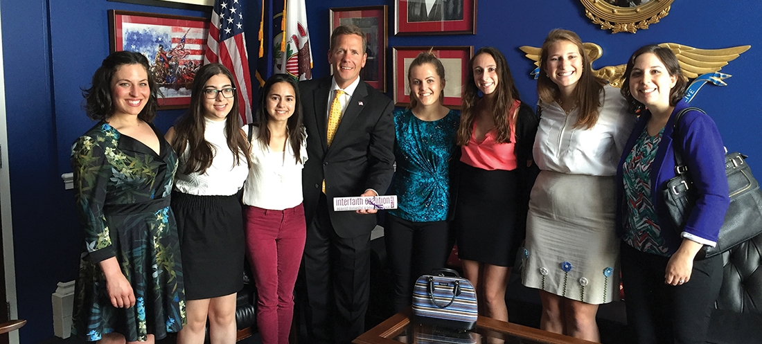 JWI staff and interns deliver the Interfaith Coalition's call to action to Rep. Bob Dold on June 9, 2016.