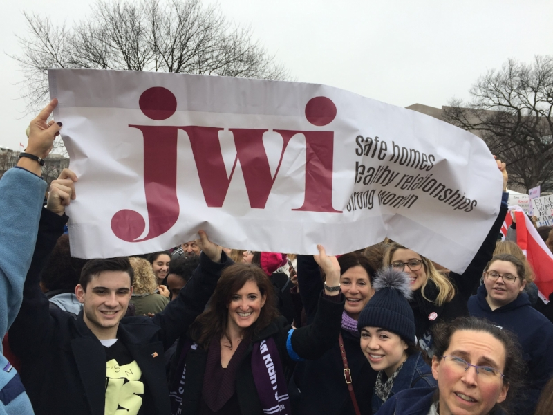 Photo by Lauren Landau  Left to right: Jules Jacobs, JWI VP of Communications Meredith Jacobs, JWI CEO Lori Weinstein, Emma Bethel, Chloe Bethel, Dr. Robyn Jacobs, and Erica Basta at the Women's March on Washington, January 21, 2017.