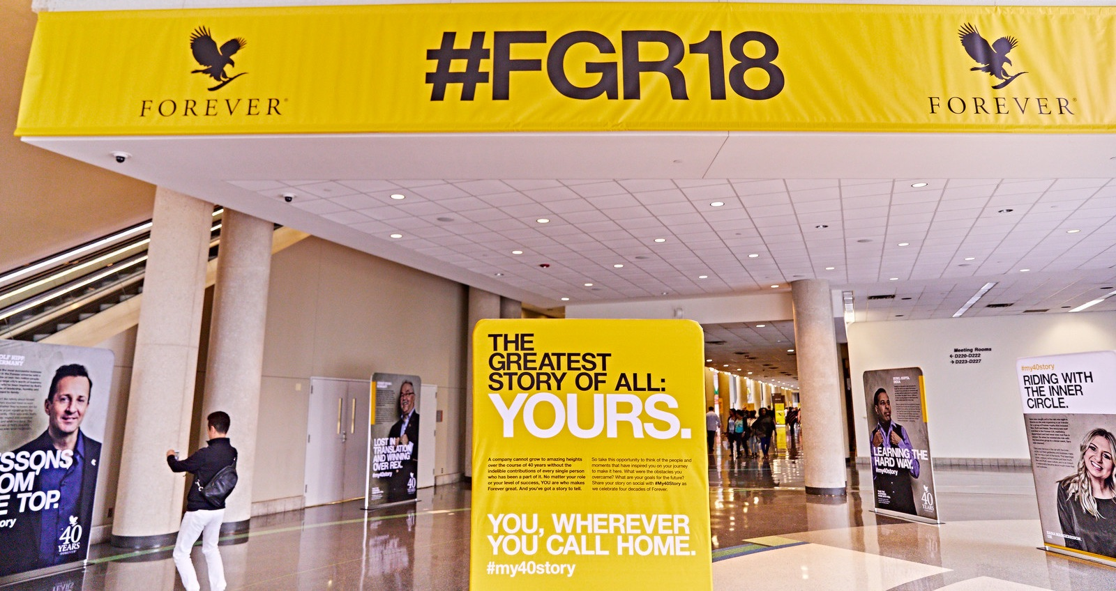 """Each story also had a """"short version"""" that was turned into a poster series. These 40 posters lined the hall at the Dallas Convention Center leading into the rally for a week."""