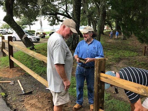 Randy and Mike supervise Bill