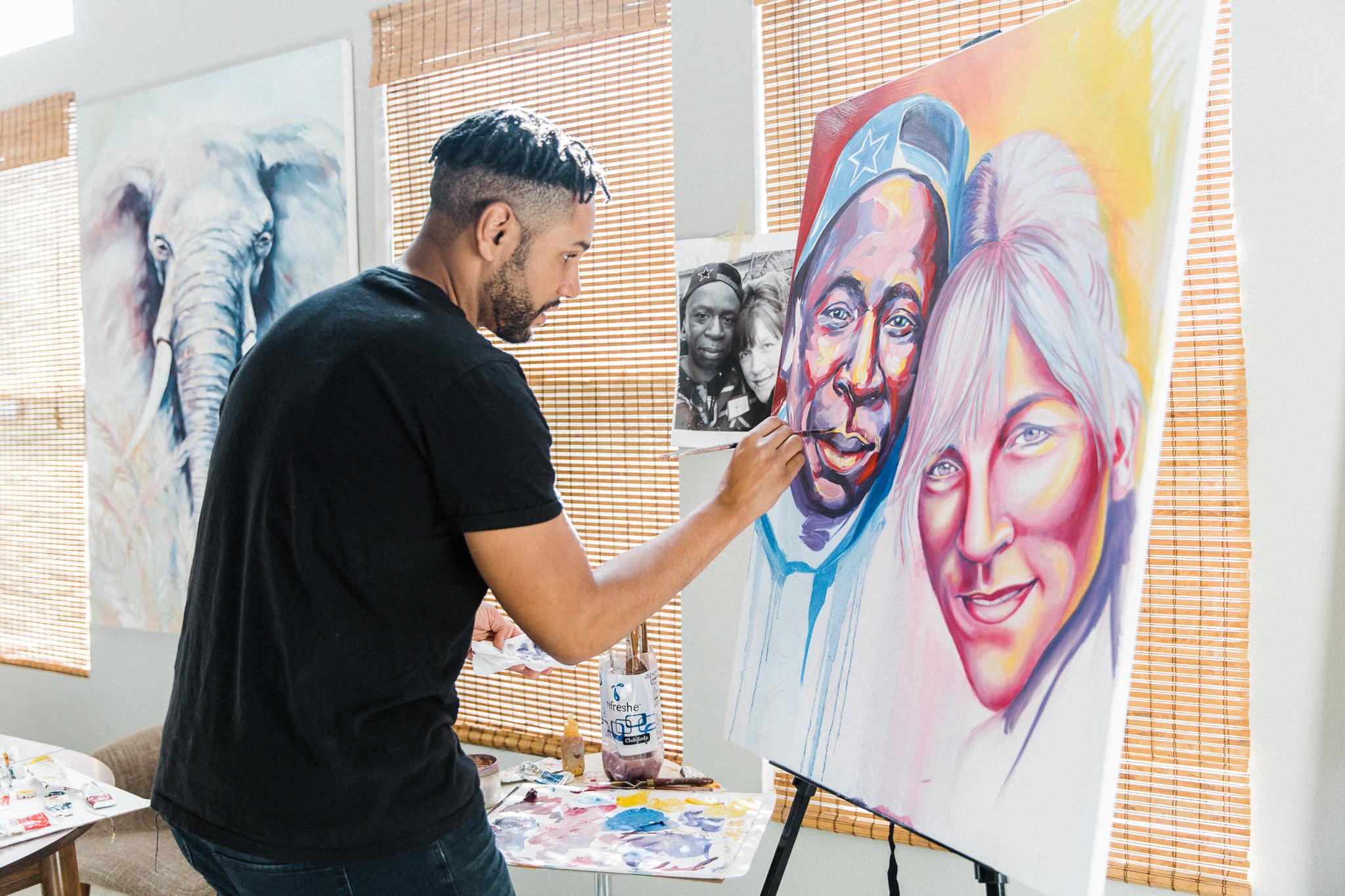 Brian Peterson painting Faces of Santa Ana