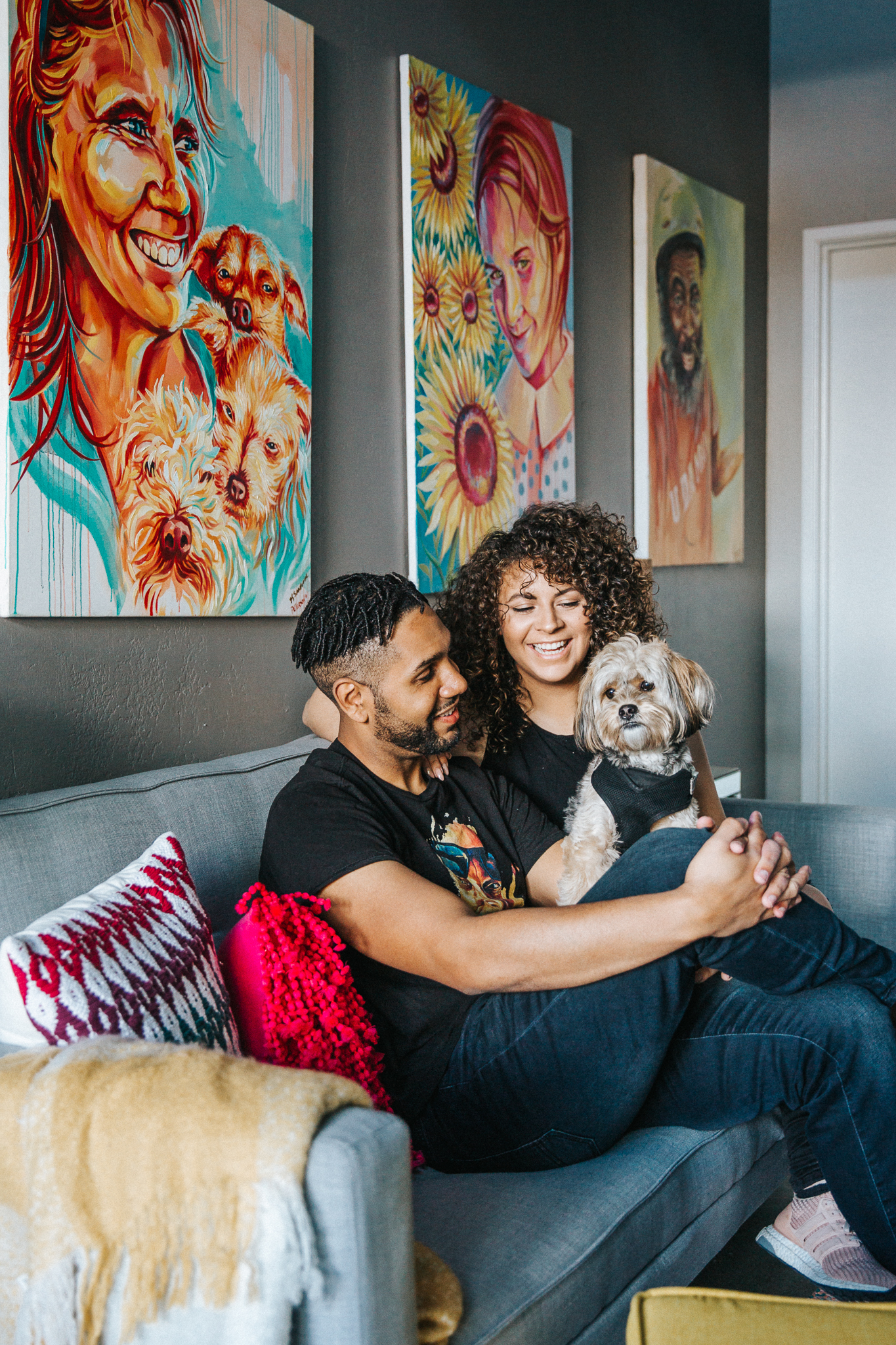 Brian and Vanessa Peterson sitting on couch with dog
