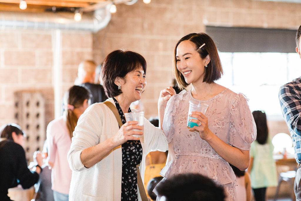 2 women laughing Chriselle Lim Unicorn Girls Party OC LA Lifestyle Event Photographer Joy Theory Co