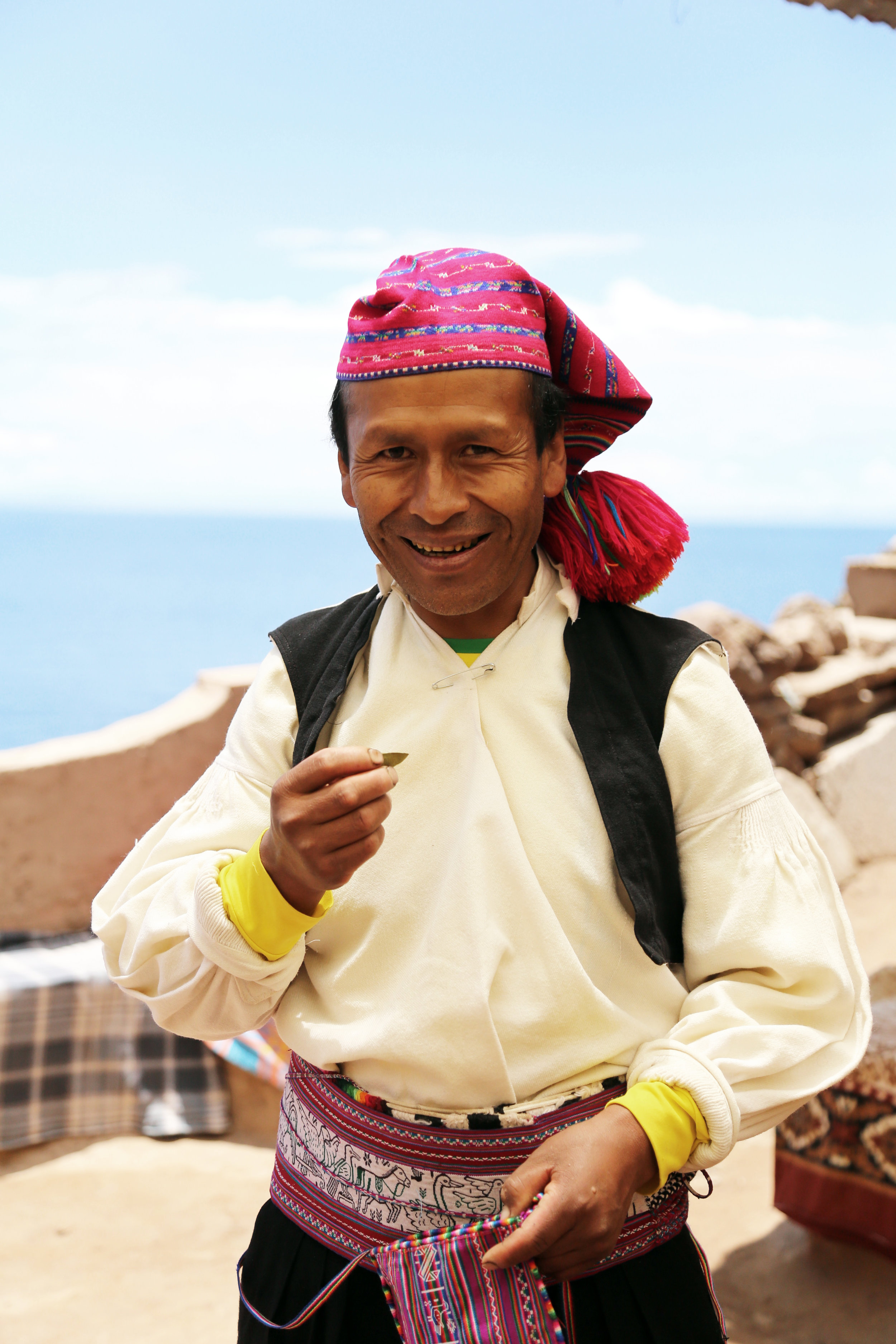 A married man eating coca leaves (yes, the kind that makes cocaine). In Peru coca leaves are a big part of the culture. They are suppose to help with altitude sickness and provide energy.